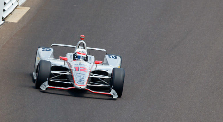 Will Power enters Turn 4 on the last lap prior to winning the 102nd running of the Indianapolis 500 on May 27, 2018, at Indianapolis Motor Speedway.