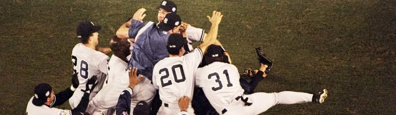 The Yankees celebrate winning the World Series against the Padres on Oct. 21, 1998, at Qualcomm Stadium in San Diego.