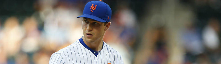 Jacob deGrom pauses before pitching against the Tampa Bay Rays in the first inning at Citi Field.