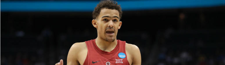 Trae Young reacts against the Rhode Island Rams during the first half in the first round of the 2018 NCAA Tournament at PPG Paints Arena in Pittsburgh.