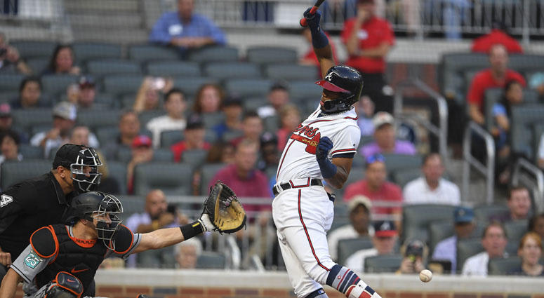 Braves left fielder Ronald Acuna Jr. is hit by the first pitch of the game against the Miami Marlins on Aug. 15, 2018, at SunTrust Park in Atlanta.