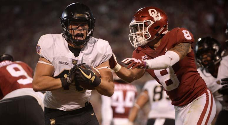 Army running back Andy Davidson scores a touchdown in front of Oklahoma safety Kahlil Haughton on Sept. 22, 2018, at Gaylord Family - Oklahoma Memorial Stadium in Norman, Oklahoma.