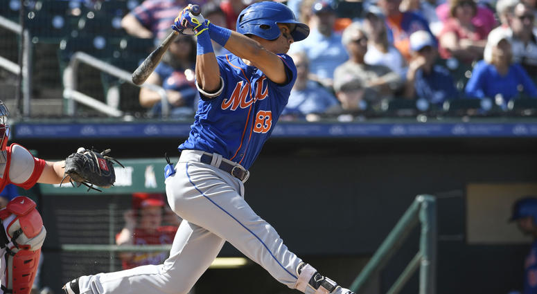 Mar 18, 2017; Jupiter, FL, USA; New York Mets shortstop Andres Gimenez (83) connects for a base hit against the St. Louis Cardinals during a spring training game at Roger Dean Stadium. The Mets defeated the Cardinals 5-4. Mandatory Credit: Scott Rovak-USA