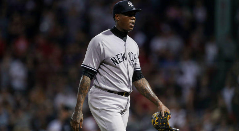 Aroldis Chapman reacts after giving up the tying run during the ninth inning against the Boston Red Sox at Fenway Park.