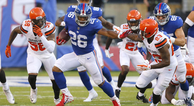 Giants running back Saquon Barkley (26) rushes against the Cleveland Browns on Aug. 9, 2018, at MetLife Stadium.