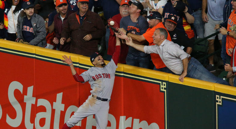 Red Sox right fielder Mookie Betts tries to catch a fly ball hit by the Astros' Jose Altuve in Game 4 of the ALCS on Oct. 17, 2018, at Minute Maid Park in Houston.