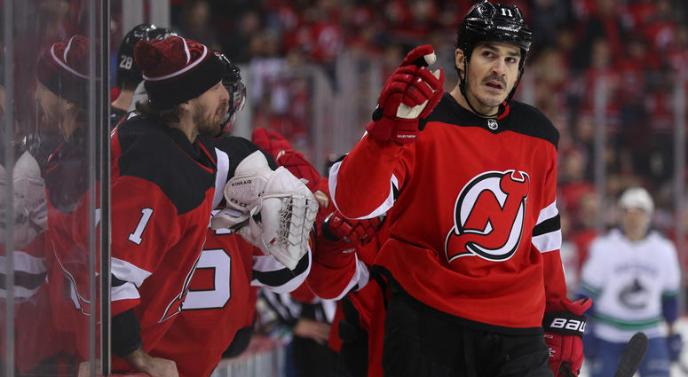 Dec 31, 2018; Newark, NJ, USA; New Jersey Devils center Brian Boyle (11) points to the stands after a scoring a goal during the first period of their game against the Vancouver Canucks at Prudential Center. Mandatory Credit: Ed Mulholland-USA TODAY Sports