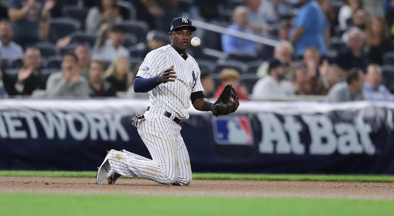 Adeiny Hechavarria of the Yankees reacts after making an out against the Oakland Athletics during the American League wild-card game on Oct. 3, 2 at Yankee Stadium.