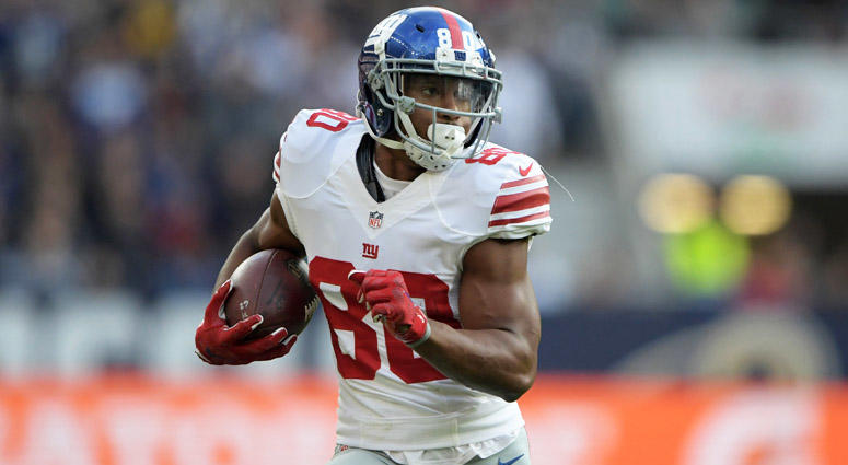 Giants receiver Victor Cruz looks for more yardage after catching a pass against the Los Angeles Rams on Oct. 23, 2016, at Twickenham Stadium in London.