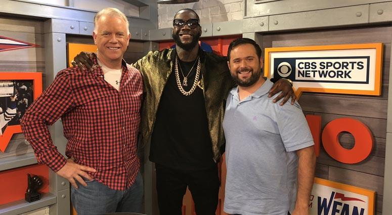 Deontay Wilder poses with WFAN's Boomer and Gio on Oct. 1, 2018.