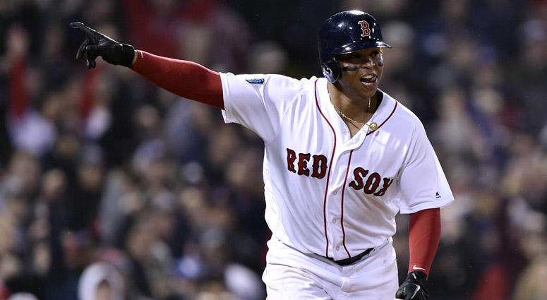 Red Sox third baseman Rafael Devers celebrates his RBI single against the Los Angeles Dodgers in Game 1 of the World Series on Oct. 23, 2018, at Fenway Park.