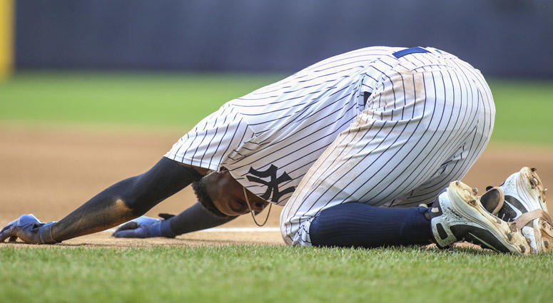 Yankees shortstop Didi Gregorius falls to the ground after a collision at first base against the Toronto Blue Jays on Aug. 19, 2018, at Yankee Stadium.