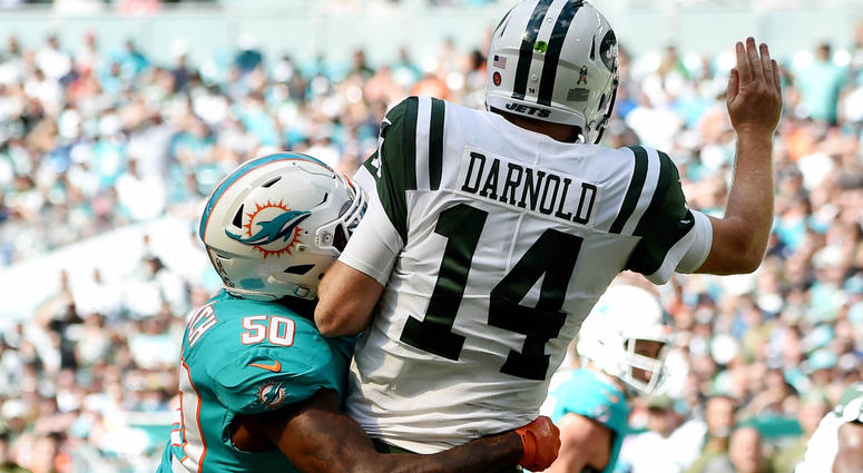Nov 4, 2018; Miami Gardens, FL, USA; Miami Dolphins defensive end Andre Branch (50) hits New York Jets quarterback Sam Darnold (14) during the first half at Hard Rock Stadium. Mandatory Credit: Steve Mitchell-USA TODAY Sports
