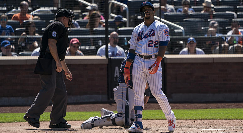New York Mets first baseman Dominic Smith (22) reacts to striking out during the eighth inning of the game at Citi Field on Jul 8, 2018.