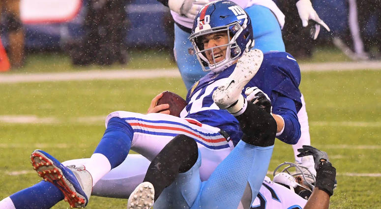 Dec 16, 2018; East Rutherford, NJ, USA; New York Giants quarterback Eli Manning (10) gets sacked by Tennessee Titans cornerback Logan Ryan (26) during the 2nd quarter at MetLife Stadium. Mandatory Credit: Robert Deutsch-USA TODAY Sports