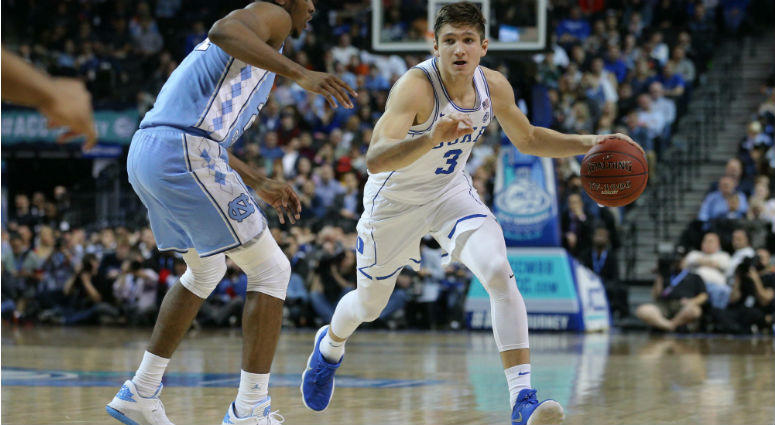 Grayson Allen controls the ball against Kenny Williams during the first half of a semifinal game of the 2018 ACC tournament at Barclays Center.
