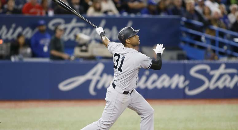 Yankees center fielder Aaron Hicks hits a three-run home run against the Blue Jays on June 5, 2018, at the Rogers Centre in Toronto.