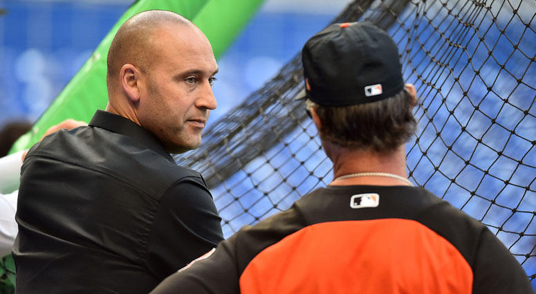 Marlins CEO Derek Jeter chats with manager Don Mattingly before a game on April 13, 2018, in Miami.