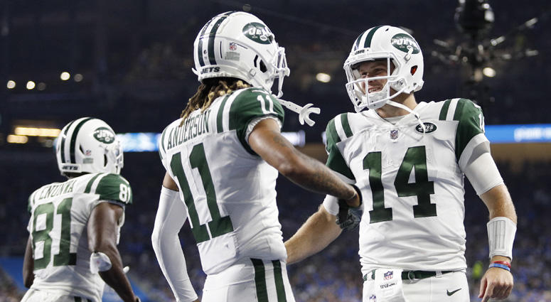 Jets wide receiver Robby Anderson (11) celebrates with quarterback Sam Darnold after the two connected for a touchdown against the Detroit Lions on Sept. 10, 2018, at Ford Field.