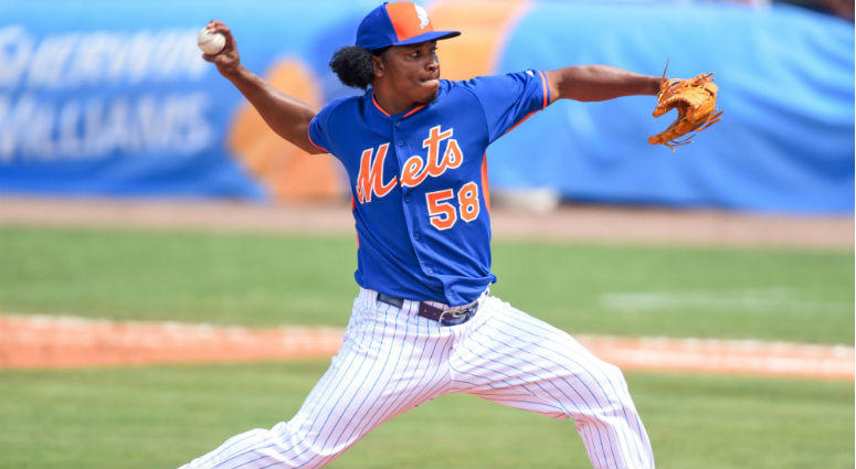 Jenrry Mejia throws against the Miami Marlins during the spring training baseball game at Tradition Field.