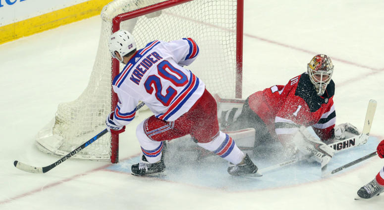 3a258a588 New Jersey Devils goaltender Keith Kinkaid makes a save on New York Rangers  left wing Chris