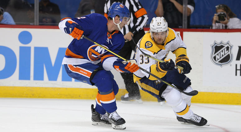 Islanders defenseman Nick Leddy and Predators left wing Viktor Arvidsson fight for the puck on Oct. 6, 2018, at Barclays Center.