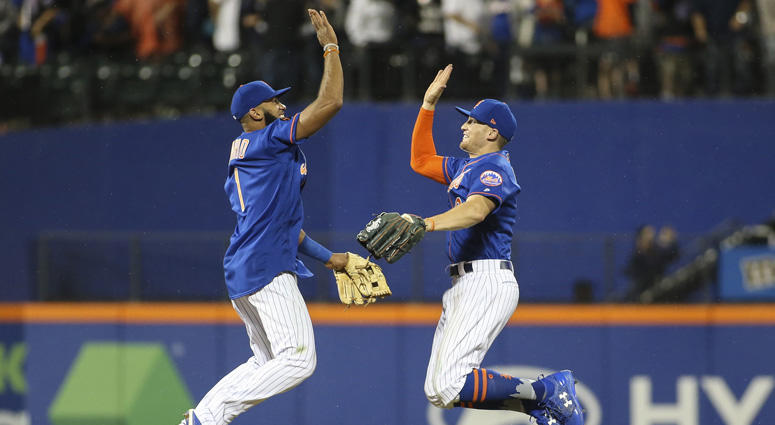Mets shortstop Amed Rosario (1) and left fielder Brandon Nimmo celebrate a 2-0 victory over the New York Yankees on June 10, 2018, at Citi Field.