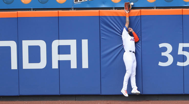 Mets left fielder Dominic Smith (22) fails to field a ball during the first inning against the Los Angeles Dodgers on June 24, 2018, at Citi Field.
