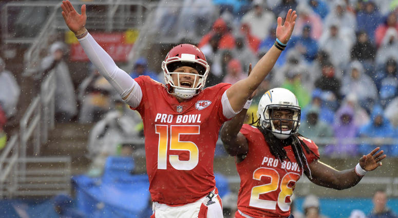 Jan 27, 2019; Orlando, FL, USA; AFC quarterback Patrick Mahomes of the Kansas City Chiefs (15) and running back Melvin Gordon (28) celebrate after a touchdown against the NFC in the NFL Pro Bowl football game Mandatory Credit: Kirby Lee-USA TODAY Sports