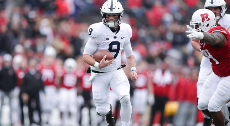Nov 17, 2018; Piscataway, NJ, USA; Penn State Nittany Lions quarterback Trace McSorley (9) rushes for yards as Rutgers Scarlet Knights defensive lineman Kevin Wilkins (99) pursues during the first half. Vincent Carchietta-USA TODAY Sports