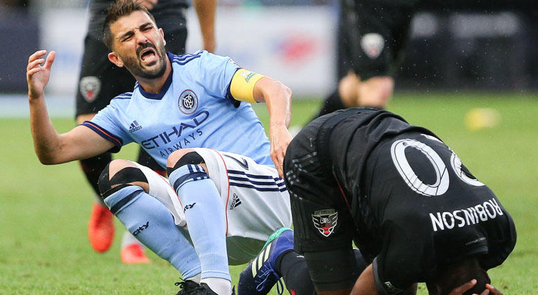 NYCFC forward David Villa reacts after colliding with with D.C. United defender Jalen Robinson for a high ball during the first half on Sept. 9, 2018, at Yankee Stadium.