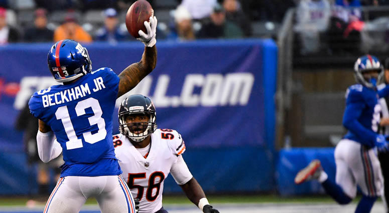 Giants wide receiver Odell Beckham Jr. throws a touchdown pass to Russell Shepard against the Bears on Dec. 2, 2018, at MetLife Stadium.