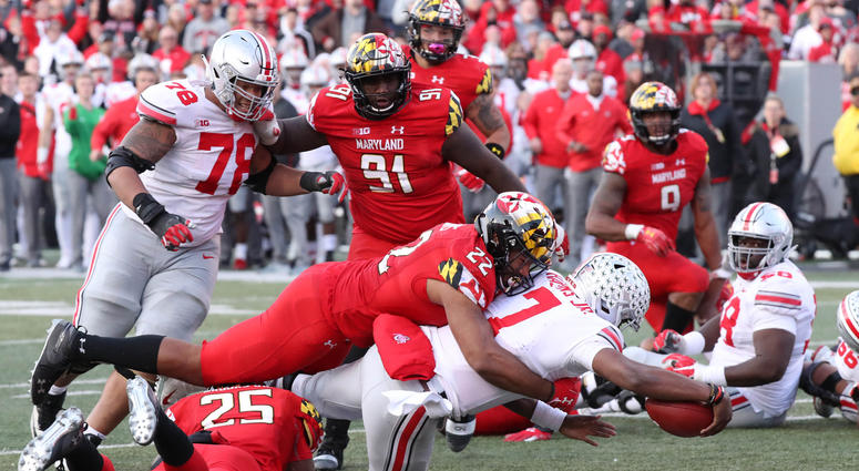 Nov 17, 2018; College Park, MD, USA; Ohio State Buckeyes quarterback Dwayne Haskins (7) dives for the game winning touchdown in overtime against the Maryland Terrapins at Capital One Field at Maryland Stadium. Mitch Stringer-USA TODAY Sports