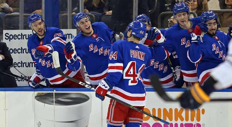New York Rangers defenseman Neal Pionk (44) celebrates his first career NHL goal against the Buffalo Sabres on March 24, 2018, at Madison Square Garden.
