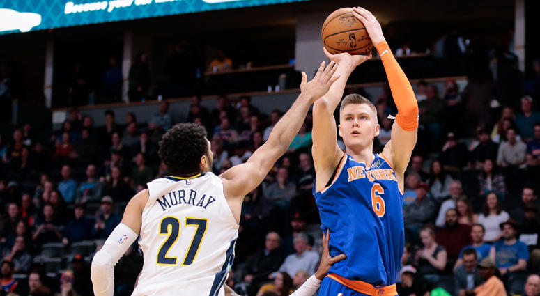 The Nuggets' Jamal Murray (27) defends on a shot from the Knicks' Kristaps Porzingis on Jan. 25, 2018, at the Pepsi Center in Denver.