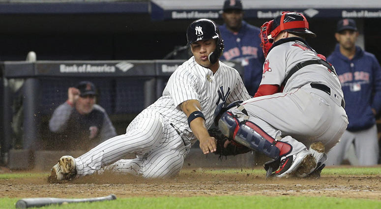 The Yankees' Gleyber Torres is tagged out by Red Sox catcher Christian Vazquez while trying to score on May 8, 2018 at Yankee Stadium.