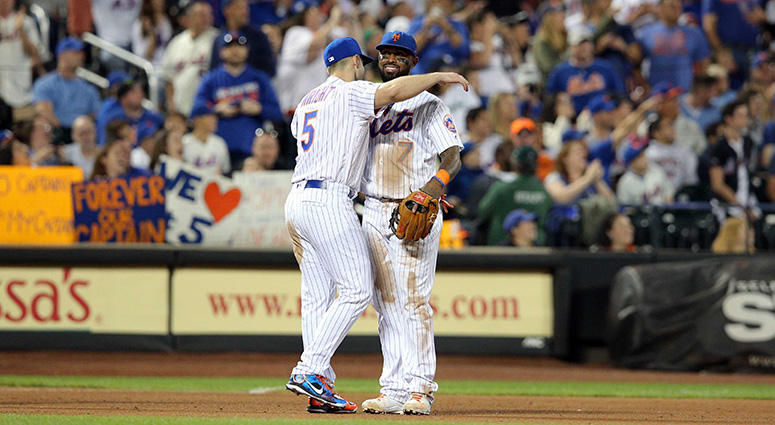 """Sep 29, 2018; New York Mets third baseman David Wright (5) hugs New York Mets shortstop Jose Reyes (7) after being shown on the \""""kiss cam\"""" during the fifth inning against the Miami Marlins at Citi Field. Brad Penner-USA TODAY Sports"""