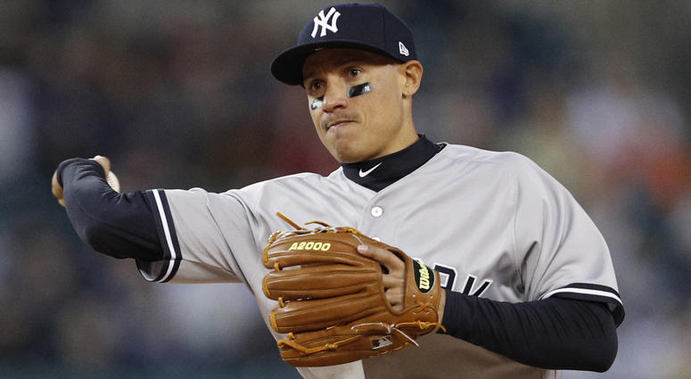 New York Yankees second baseman Ronald Torreyes throws to first base for an out during the third inning against the Detroit Tigers at Comerica Park.