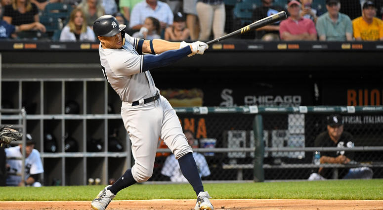 Giancarlo Stanton hits a grand slam home run against the Chicago White Sox during the second inning on Aug. 7, 2018, at Guaranteed Rate Field, in Chicago.