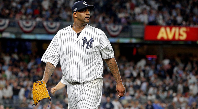 Bronx, NY, USA; New York Yankees starting pitcher CC Sabathia (52) reacts after the third inning against the Boston Red Sox in game four of the 2018 ALDS playoff baseball series at Yankee Stadium. Mandatory Credit: Brad Penner-USA TODAY Sports