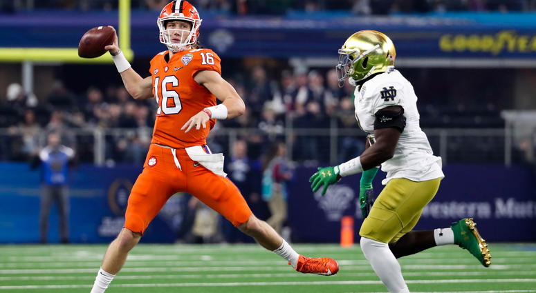 Trevor Lawrence (16) looks to pass as Notre Dame Fighting Irish linebacker  Te  f2e7dedc6