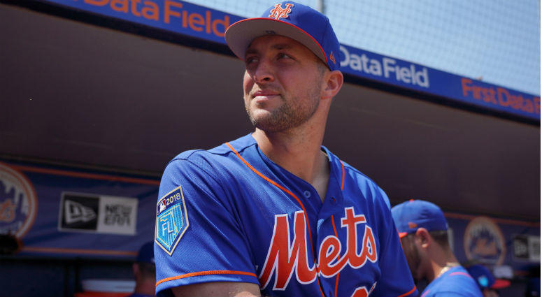 Tim Tebow  looks on from the dugout prior to the spring training game against the Miami Marlins at First Data Field.