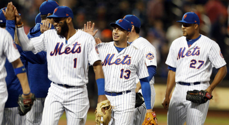 Asdrubal Cabrera celebrates with teammates Amed Rosario and Jeurys Familia after defeating the Miami Marlins at Citi Field.
