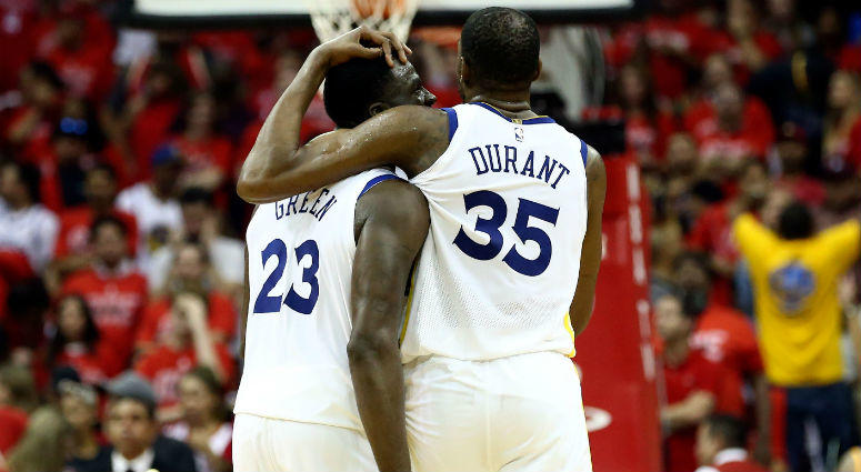 Draymond Green and Kevin Durant hug in the final seconds of the forth quarter against the Houston Rockets in game seven of the Western conference finals of the 2018 NBA Playoffs at Toyota Center in Houston.