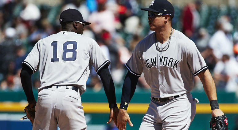 Didi Gregorius and Giancarlo Stanton celebrate after defeating the Detroit Tigers at Comerica Park in Detroit.