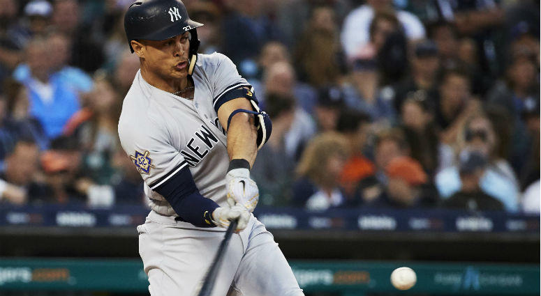 Giancarlo Stanton hits a home run in the sixth inning against the Detroit Tigers at Comerica Park in Detroit.