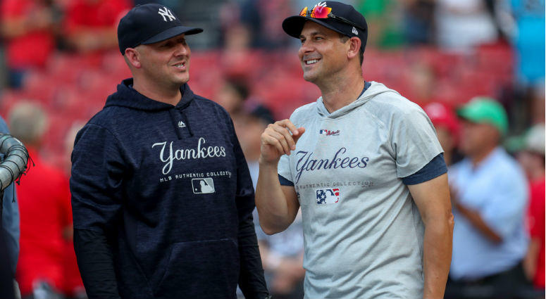 Aaron Boone and Josh Bard smile before their game against the Boston Red Sox at Fenway Park
