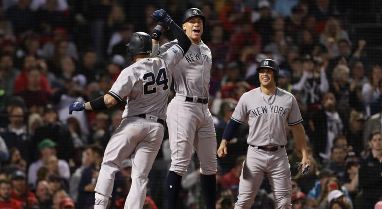 Yankees catcher Gary Sanchez (24) celebrates with right fielder Aaron Judge (99) after hitting an 3-RBI home run during the seventh inning against Boston Red Sox in game two of the 2018 ALDS playoff baseball series at Fenway Park.