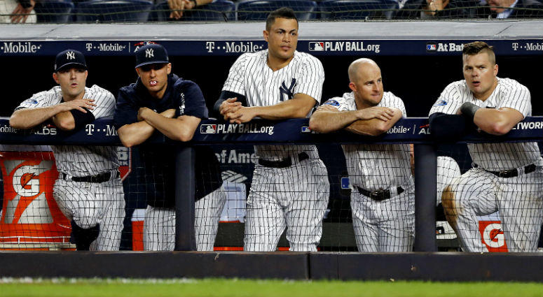 The New York Yankees dugout reacts during the eighth inning against the Boston Red Sox in game four of the 2018 ALDS playoff baseball series at Yankee Stadium.