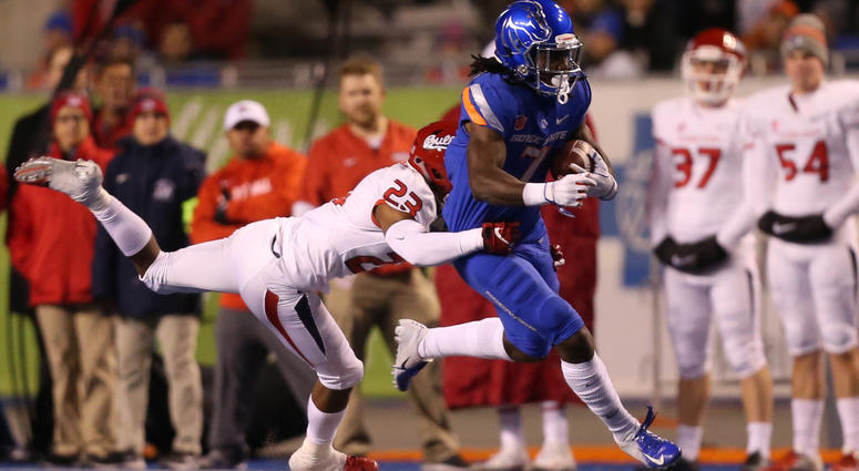 Nov 9, 2018; Boise, ID, USA; Boise State Broncos wide receiver A.J. Richardson (7) carries the ball as Fresno State Bulldogs defensive back Juju Hughes (23) tackles during the first half at Albertsons Stadium. Brian Losness-USA TODAY Sports